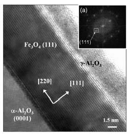 Réalisation d\'une barrière d\'alumine cristalline pour l\'obtention de composants magnétorésistifs tunnel à base de magnétite